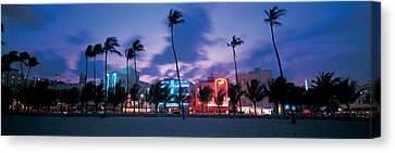 Miami Canvas Print - Buildings Lit Up At Dusk, Miami by Panoramic Images