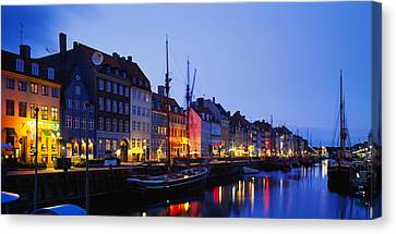 Buildings Lit Up At Night, Nyhavn Canvas Print by Panoramic Images