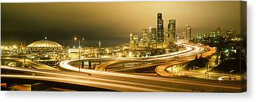 Buildings Lit Up At Night, Seattle Canvas Print by Panoramic Images