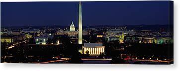 Washington Monument Canvas Print - Buildings Lit Up At Night, Washington by Panoramic Images