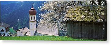 Buildings On A Hillside, Tirol, Austria Canvas Print by Panoramic Images