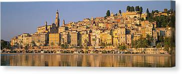 Buildings On The Waterfront, Eglise Canvas Print by Panoramic Images