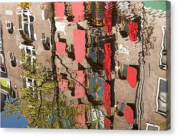 Buildings Reflected In Canal Canvas Print