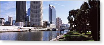 Buildings Viewed From The Riverside Canvas Print by Panoramic Images