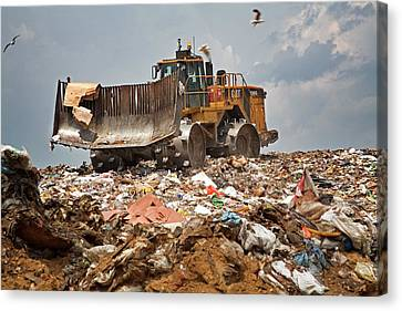 Bulldozer On A Landfill Site Canvas Print by Jim West