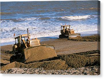 Bulldozers Rebuilding Beach Canvas Print by Ashley Cooper