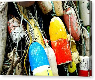 Buoys Canvas Print by Mamie Gunning