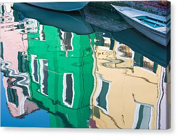 Burano Reflected Canvas Print by Joan Herwig
