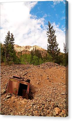 Buried Mining Equipment Canvas Print by Jeff Swan