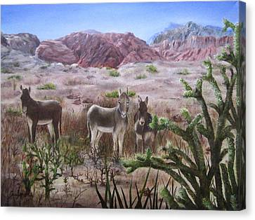 Burros At Red Rock Canvas Print by Roseann Gilmore