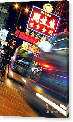 Bus Race In Mong Kok Canvas Print by Lars Ruecker