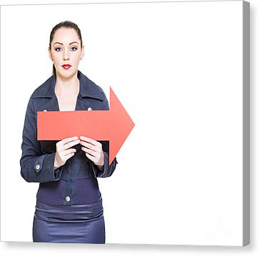 Business Woman Holding Direction Arrow Sign Canvas Print by Jorgo Photography - Wall Art Gallery