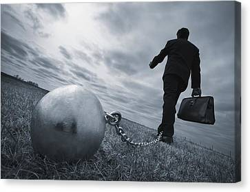Businessman With Ball And Chain Canvas Print