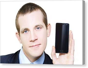 Businessman With Blank Screen Smartphone In Hand Canvas Print by Jorgo Photography - Wall Art Gallery