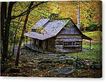Cabin In The Woods Canvas Print by Lawrence Golla