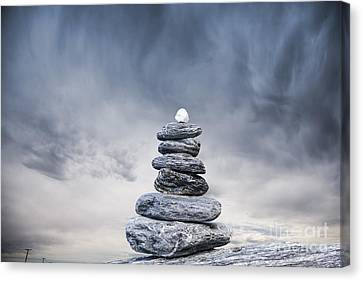 Cairn And Stormy Sky Canvas Print by Colin and Linda McKie