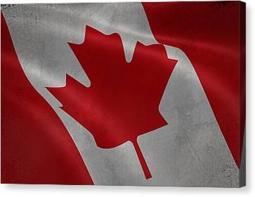 Canadian Flag Waving Aged Canvas Canvas Print by Eti Reid