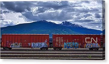 Canadian Freight Train In Jasper Canvas Print by Stuart Litoff