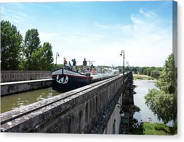 Towpath Canvas Print - Canal Boat On The Briare Aqueduct by Louise Murray