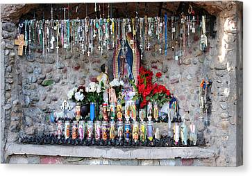 Candels And Rosaries Canvas Print by Carla P White