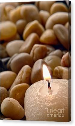 Candle On The Rocks Canvas Print by Olivier Le Queinec