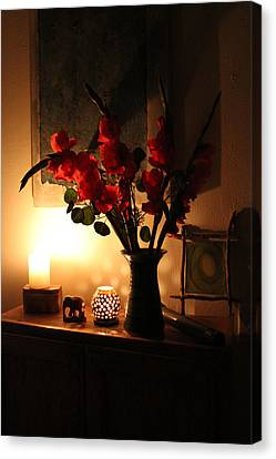 Candles And Orange Gladiolus Canvas Print by Ron McMath