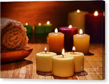 Candles Burning In A Spa  Canvas Print by Olivier Le Queinec