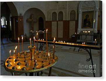 Candles Inside The Tsminda Sameba Cathedral Tbilisi Canvas Print by Robert Preston