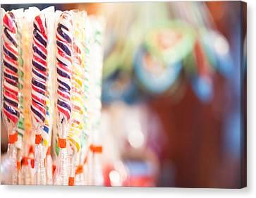 Candy Sticks At German Christmas Market Canvas Print by Susan Schmitz