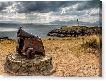 Cannon At Llanddwyn  Canvas Print by Adrian Evans