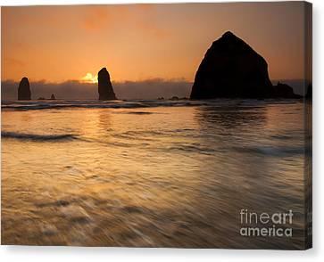 Cannon Beach Tides Canvas Print by Mike Dawson