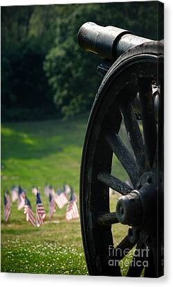 Cannon Memorial With American Flags Canvas Print by Amy Cicconi