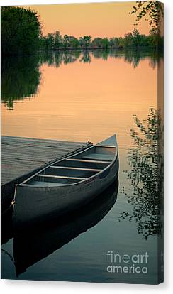Canoe At A Dock At Sunset Canvas Print by Jill Battaglia