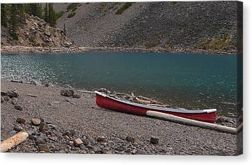 Canoe At Moraine Lake Canvas Print by Cheryl Miller