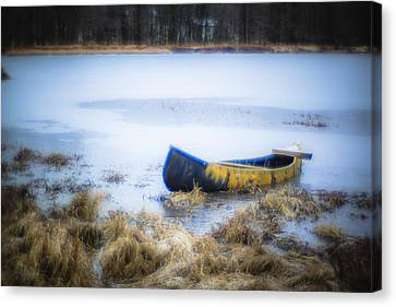 Canoe At The Frozen Lake Canvas Print