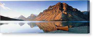 Canoe At The Lakeside, Bow Lake, Banff Canvas Print by Panoramic Images
