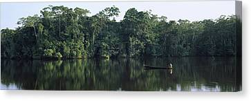 Canoe In A River, Napo River, Oriente Canvas Print by Panoramic Images