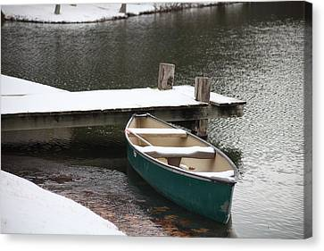 Canoe In Winter Canvas Print