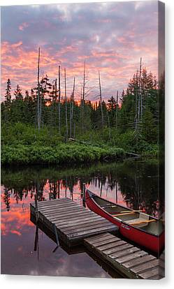 Canoe Next To The Cold Stream Canvas Print by Jerry and Marcy Monkman