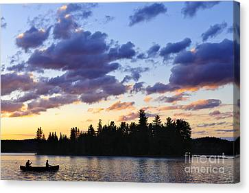 Canoeing At Sunset Canvas Print by Elena Elisseeva