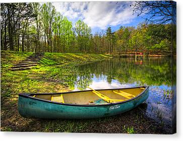 Canoeing At The Lake Canvas Print by Debra and Dave Vanderlaan