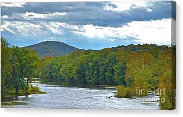 Canoeing The River Canvas Print