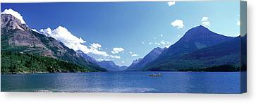 Canoeing Waterton Lake Waterton Glacier Canvas Print by Panoramic Images