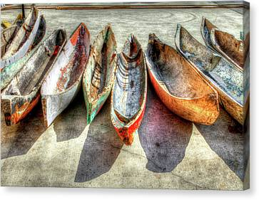 Ancient Canvas Print - Canoes by Debra and Dave Vanderlaan