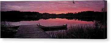 Canoes Lake Yxtaholm Sweden Canvas Print by Panoramic Images