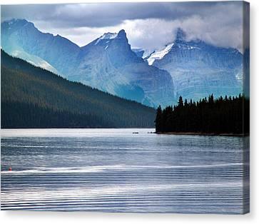 Canoes On Lake Maligne Canvas Print