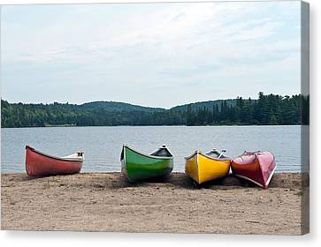 Canoes On The Lake Canvas Print by Marek Poplawski