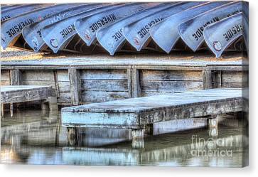 Canoes Ready For Dispatch Canvas Print by Twenty Two North Photography