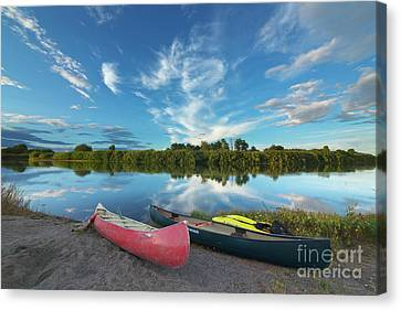 Canoes With Clouds Reflecting  Canvas Print