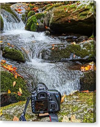 Waterfall And Camera Canvas Print by Dan Sproul